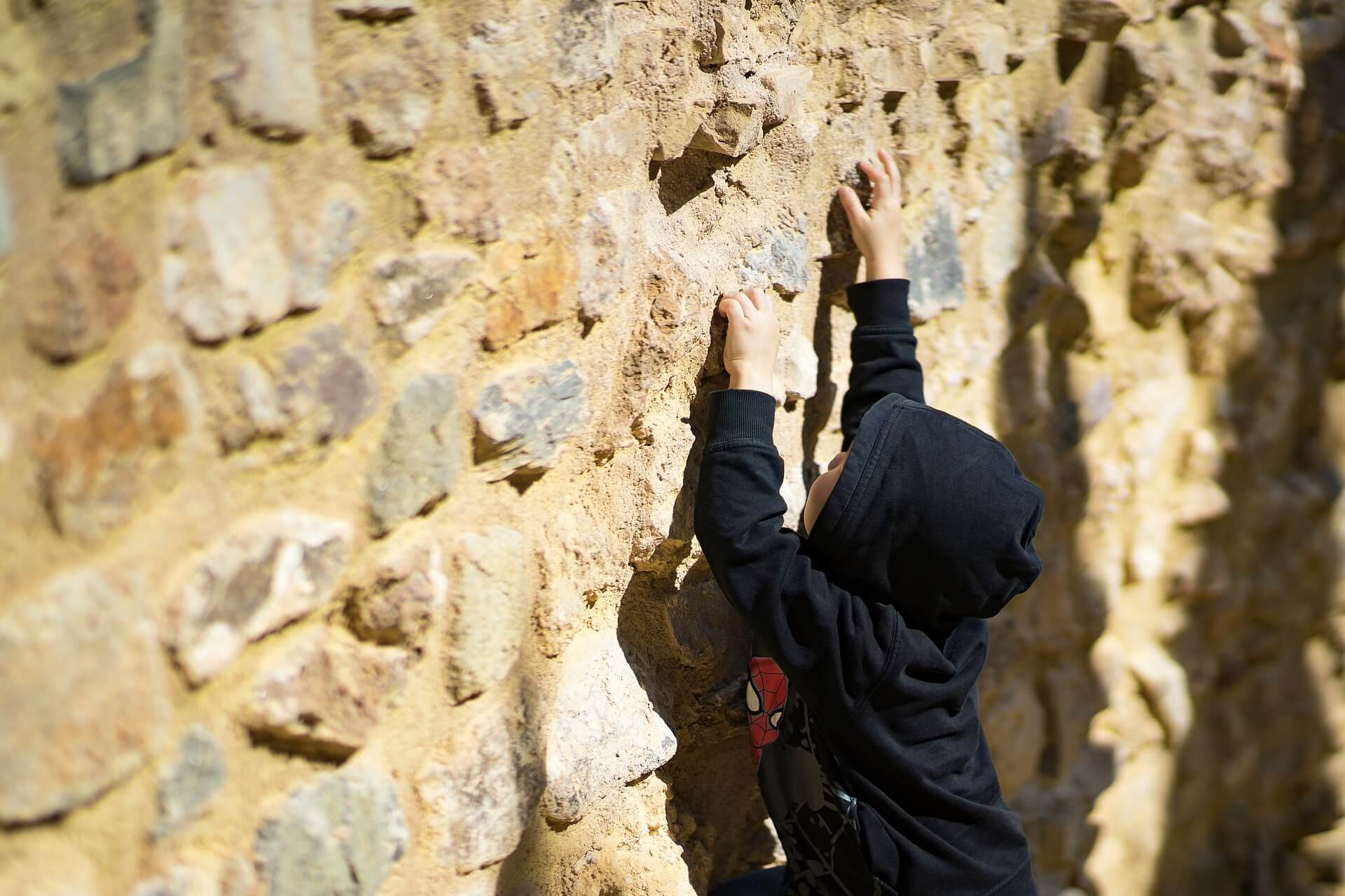 why does life suck? boy at a wall